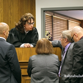 Judge Marianne Sezon and attorneys confer during a sidebar following a comment made by Kyle W. M. Starkey's attorney David PerDue during his opening statement.
